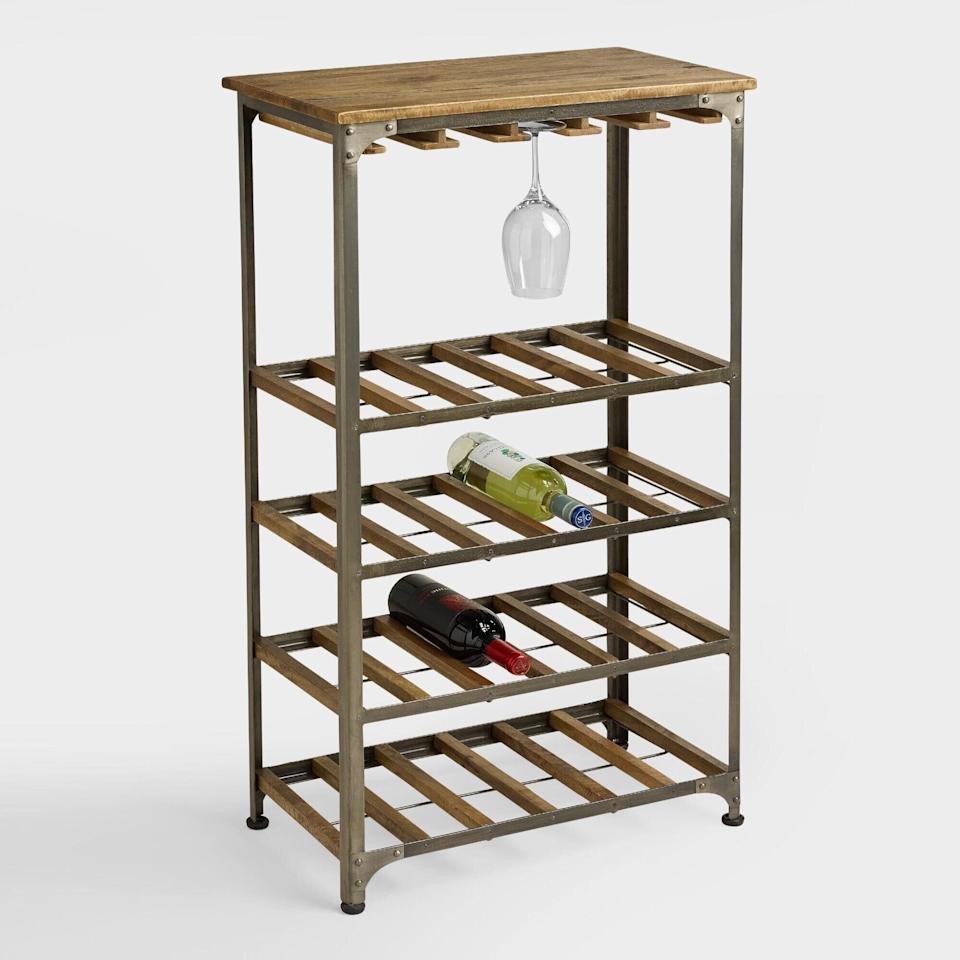 """Made ofrustic metal and mango wood, this wine rack can carry24 bottles of wine and hold up to 15 wine glasses. So now you can get back some space on your shelves.<a href=""""https://fave.co/3m6ZuyN"""" target=""""_blank"""" rel=""""noopener noreferrer"""">Find it for $160 at World Market</a>."""