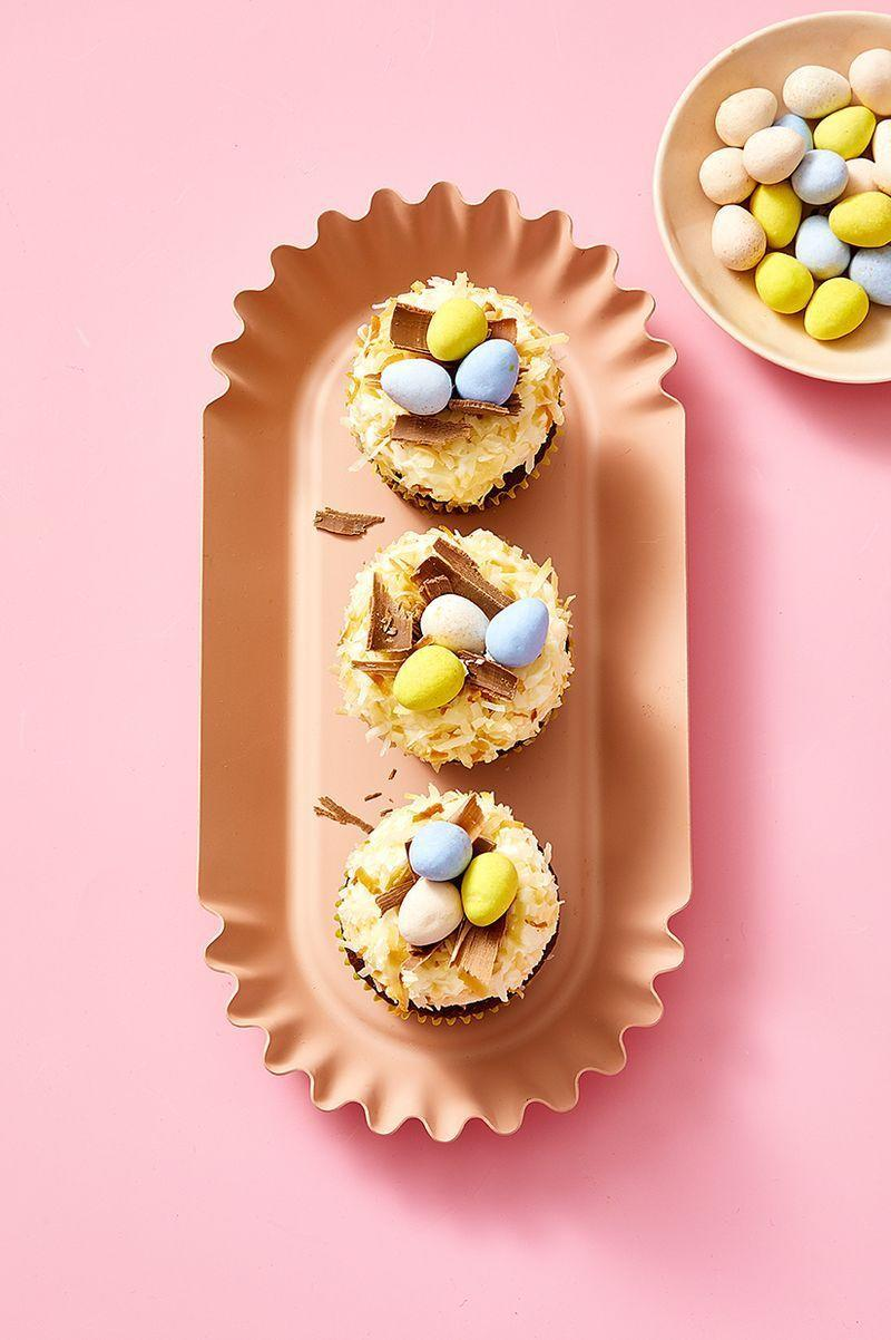 "<p>Topped with chocolate eggs and toasted coconut, these Easter cupcakes are almost too cute to eat.</p><p><em><a href=""https://www.goodhousekeeping.com/food-recipes/a31135159/easter-egg-nest-cupcakes-recipe/"" rel=""nofollow noopener"" target=""_blank"" data-ylk=""slk:Get the recipe for Nest Egg Cupcakes »"" class=""link rapid-noclick-resp"">Get the recipe for Nest Egg Cupcakes »</a></em></p>"