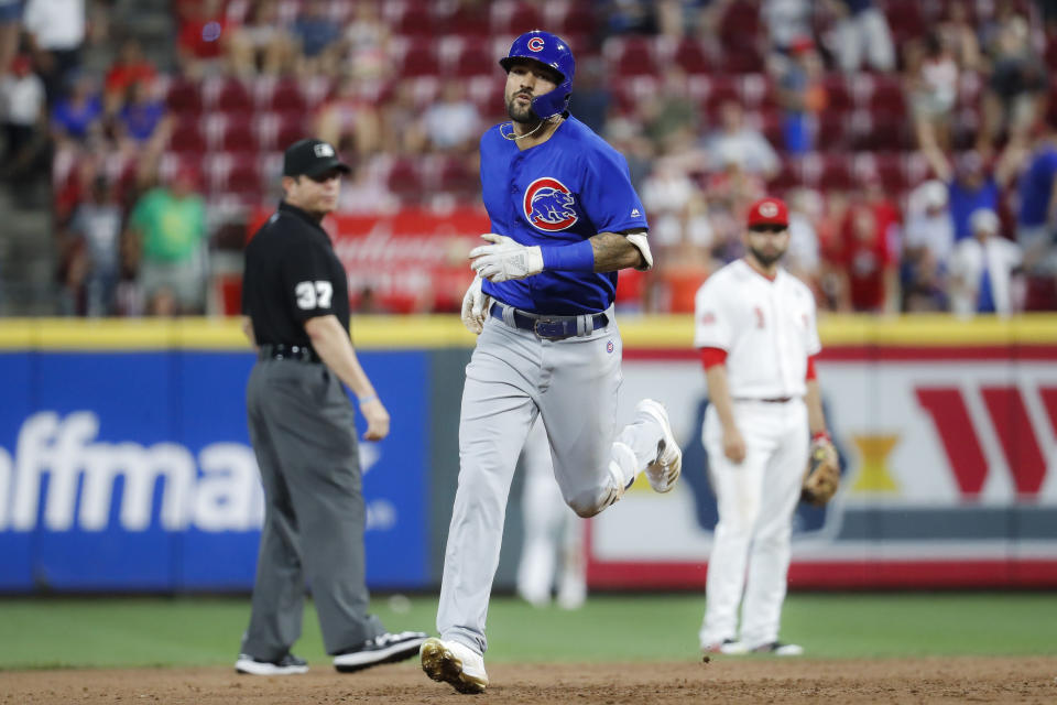 Chicago Cubs' Nicholas Castellanos runs the bases after hitting a solo home run off Cincinnati Reds starting pitcher Kevin Gausman during the fourth inning of a baseball game Thursday, Aug. 8, 2019, in Cincinnati. (AP Photo/John Minchillo)