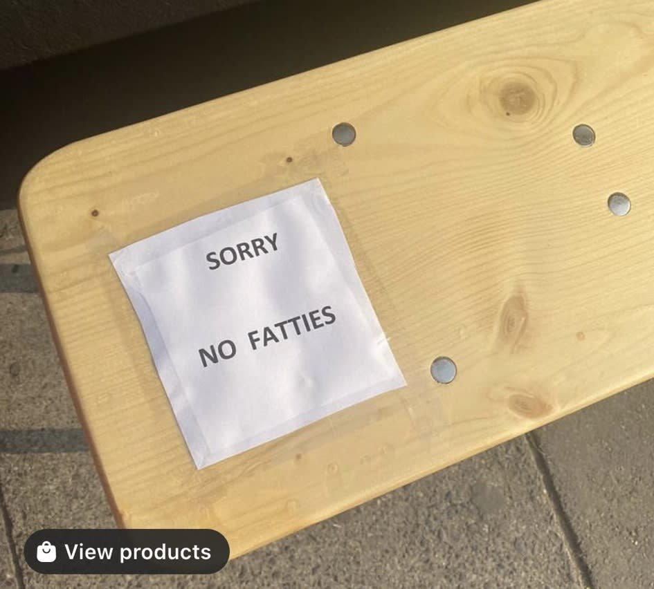 A sign placed on a bench outside the coffee shop caused uproar in the local community and on social media