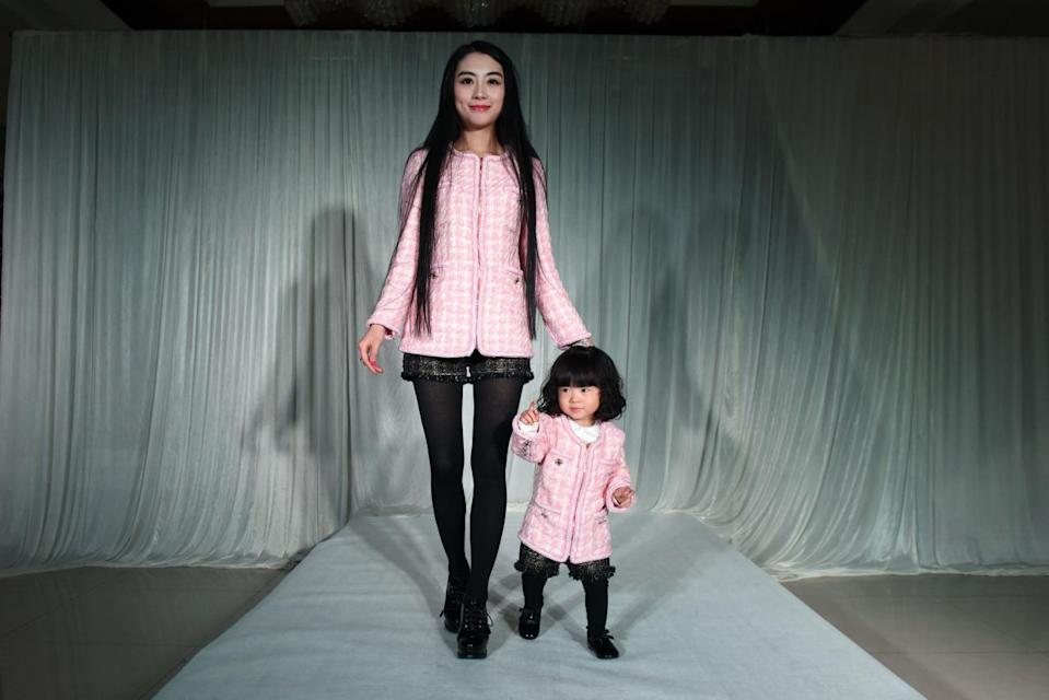It's Chanel, dahling. The pair put on pink tweed coats, black shorts, and tights for the modern working girl portion of the party.