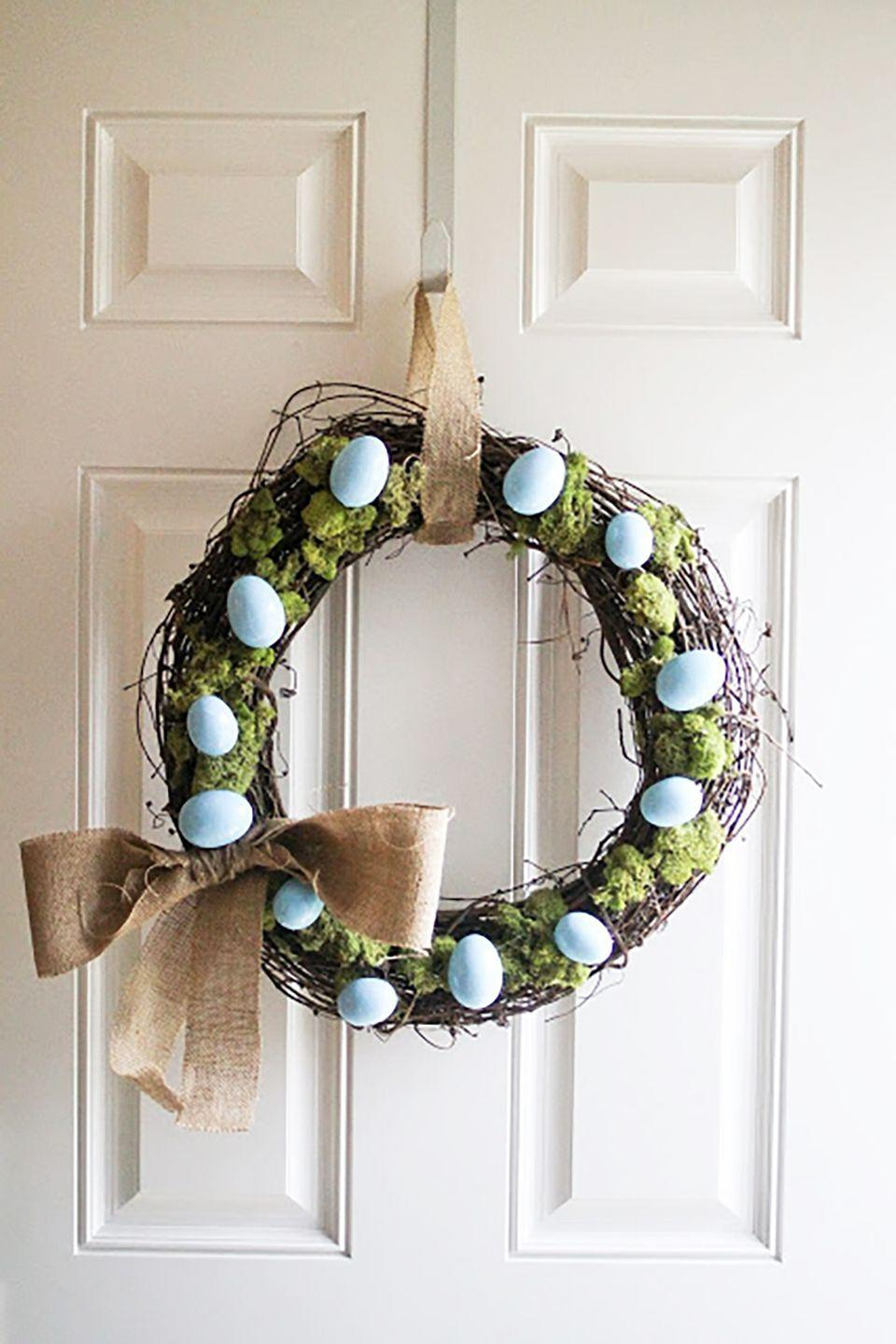 """<p>Glue moss and blue robin's eggs to a medium twig wreath and attach a burlap bow for a simple but pretty Easter look.</p><p><strong>Get the tutorial at <a href=""""http://www.iloveyoumorethancarrots.com/2013/02/diy-spring-wreath-sort-of.html"""" rel=""""nofollow noopener"""" target=""""_blank"""" data-ylk=""""slk:I Love You More Than Carrots"""" class=""""link rapid-noclick-resp"""">I Love You More Than Carrots</a>.</strong></p><p><strong><strong><a class=""""link rapid-noclick-resp"""" href=""""https://www.amazon.com/Bulk-Buy-Darice-Grapevine-Wreath/dp/B0033M0HG4?tag=syn-yahoo-20&ascsubtag=%5Bartid%7C10050.g.4088%5Bsrc%7Cyahoo-us"""" rel=""""nofollow noopener"""" target=""""_blank"""" data-ylk=""""slk:SHOP GRAPEVINE WREATHS"""">SHOP GRAPEVINE WREATHS</a></strong></strong></p>"""