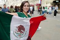 <p>A female fan of Mexico holding the flag of her nation prior to the 2018 FIFA World Cup Russia in Nikolskaya Street a pedestrian street in the Kitay-Gorod of Moscow on June 13, 2018 in Moscow, Russia. (Photo by Matthew Ashton – AMA/Getty Images) </p>