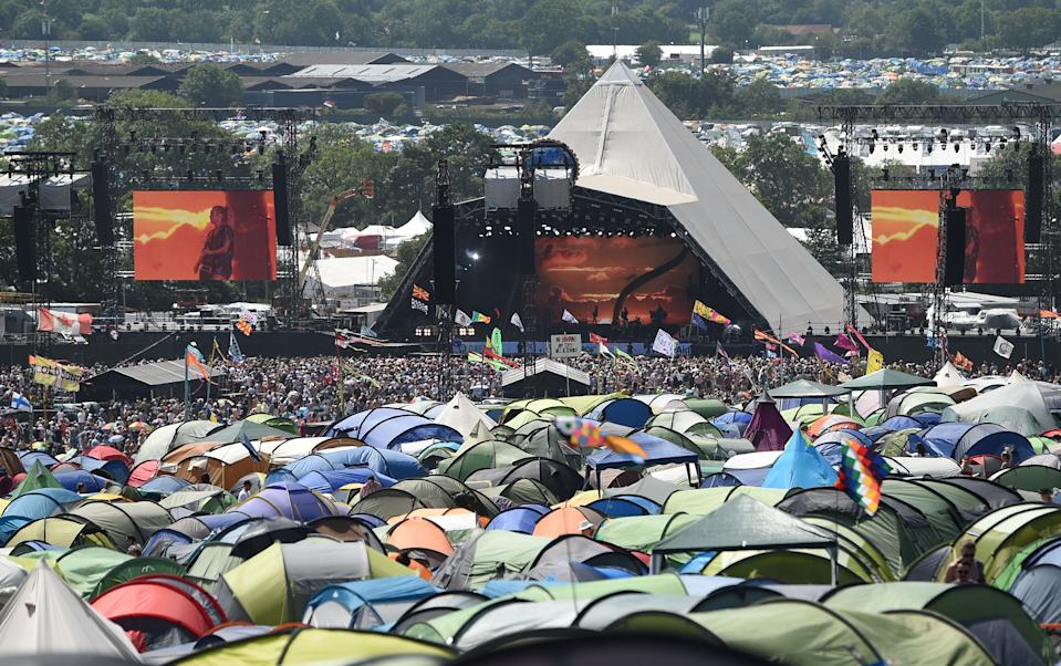 The Pyramid stage at the Glastonbury Festival of Music and Performing Arts is pictured beyond rows of tents on Worthy Farm near the village of Pilton in Somerset, South West England, on June 29, 2019. (Photo by Oli SCARFF / AFP)        (Photo credit should read OLI SCARFF/AFP via Getty Images)