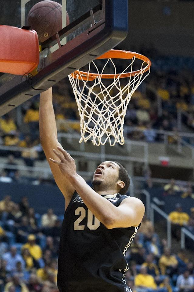 Purdue's A.J. Hammons (20) lays in a basket during the first half of an NCAA college basketball game against West Virginia, Sunday, Dec. 22, 2013, in Morgantown, W.Va. (AP Photo/Andrew Ferguson)
