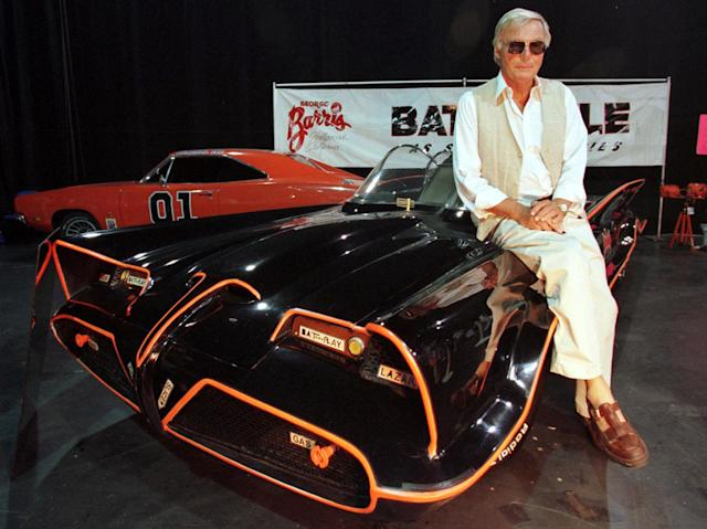"<p>Adam West, who portrayed the title character in the 1960's television series ""Batman,"" poses atop the original Batmobile used in the hit series during an appearance at the first annual RetroFest, Aug. 14, 1999, in Santa Monica. The RetroFest, a three day pop culture festival celebrating the 1950's, 60's and 70's, was sponsored by Rhino Records and cable television channel TV Land. (Photo: Rose Prouser/Reuters) </p>"