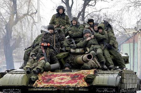 Members of the armed forces of the separatist self-proclaimed Donetsk People's Republic drive a tank on the outskirts of Donetsk, Ukraine, in this January 22, 2015 file photo. REUTERS/Alexander Ermochenko/Files