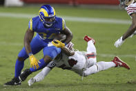 Los Angeles Rams running back Malcolm Brown (34) is tackled by San Francisco 49ers middle linebacker Fred Warner (54) during the second half of an NFL football game in Santa Clara, Calif., Sunday, Oct. 18, 2020. (AP Photo/Jed Jacobsohn)