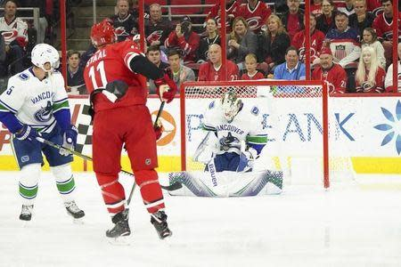Oct 9, 2018; Raleigh, NC, USA; Vancouver Canucks goaltender Jacob Markstrom (25) stops Carolina Hurricanes center Jordan Staal (11) shot during the first period at PNC Arena. Mandatory Credit: James Guillory-USA TODAY Sports