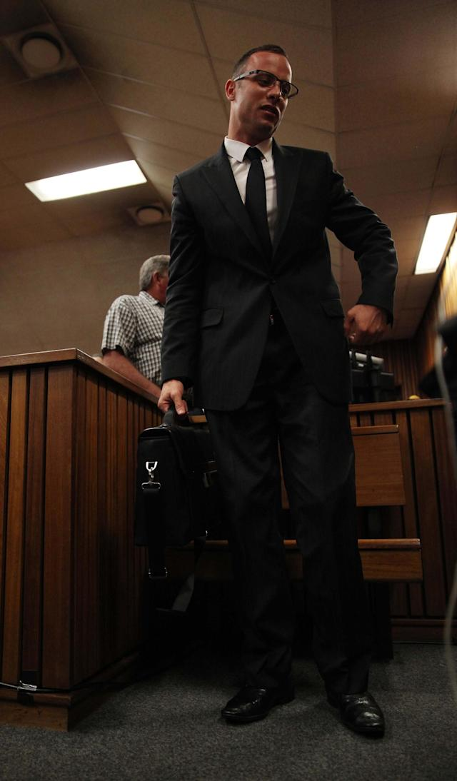 Oscar Pistorius leaves the dock after the prosecution closed its case in his murder trial in Pretoria, South Africa, Tuesday, March 25, 2014. Pistorius is charged with the Valentines Day 2013 shooting death of his girlfriend Reeva Steenkamp. (AP Photo/Esa Alexander, Pool)