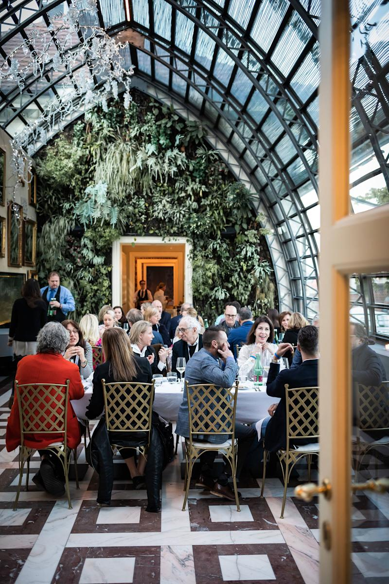 """Attendees dine in the Nelahozeves Castle courtyard following a morning session of """"Czech University,"""" featuring lessons in traditional Bohemian dance, Czech holiday table decorating, and a tour of the castle."""