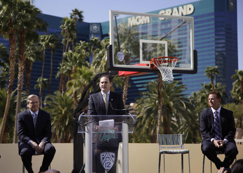 Flanked by Pat Christenson, president of Las Vegas Events, left, and MGM COO and president Scott Sibella, right, Pac-12 commissioner Larry Scott speaks about bringing the Pac-12 basketball tournament to Las Vegas, Tuesday, March 13, 2012, in Las Vegas. Las Vegas will begin hosting the tournament in 2013 (AP Photo/Julie Jacobson)