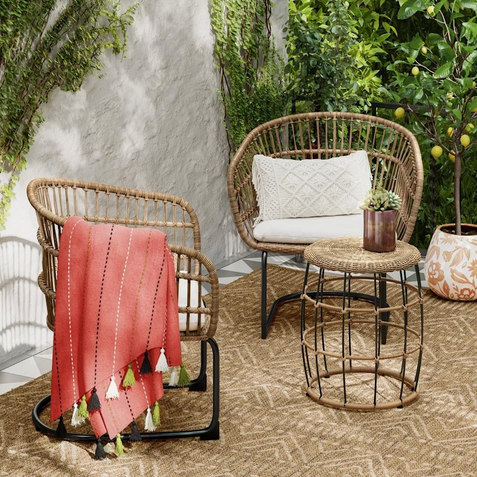 """<p>Bohemian style is all the rage, and this <a href=""""https://www.popsugar.com/buy/Southport-Wicker-Motion-Patio-Chat-Set-430114?p_name=Southport%20Wicker%20Motion%20Patio%20Chat%20Set&retailer=target.com&pid=430114&price=400&evar1=casa%3Aus&evar9=46144610&evar98=https%3A%2F%2Fwww.popsugar.com%2Fhome%2Fphoto-gallery%2F46144610%2Fimage%2F46144614%2FSouthport-Wicker-Motion-Patio-Chat-Set&list1=shopping%2Ctarget%2Csmall%20spaces%2Csmall%20space%20living%2Capartment%20living%2Coutdoor%20decorating%2Caffordable%20decor%2Chome%20shopping&prop13=api&pdata=1"""" rel=""""nofollow"""" data-shoppable-link=""""1"""" target=""""_blank"""" class=""""ga-track"""" data-ga-category=""""Related"""" data-ga-label=""""https://www.target.com/p/southport-3pc-wicker-motion-patio-chat-set-linen-opalhouse-153/-/A-53788890"""" data-ga-action=""""In-Line Links"""">Southport Wicker Motion Patio Chat Set </a> ($400) exemplifies that.</p>"""