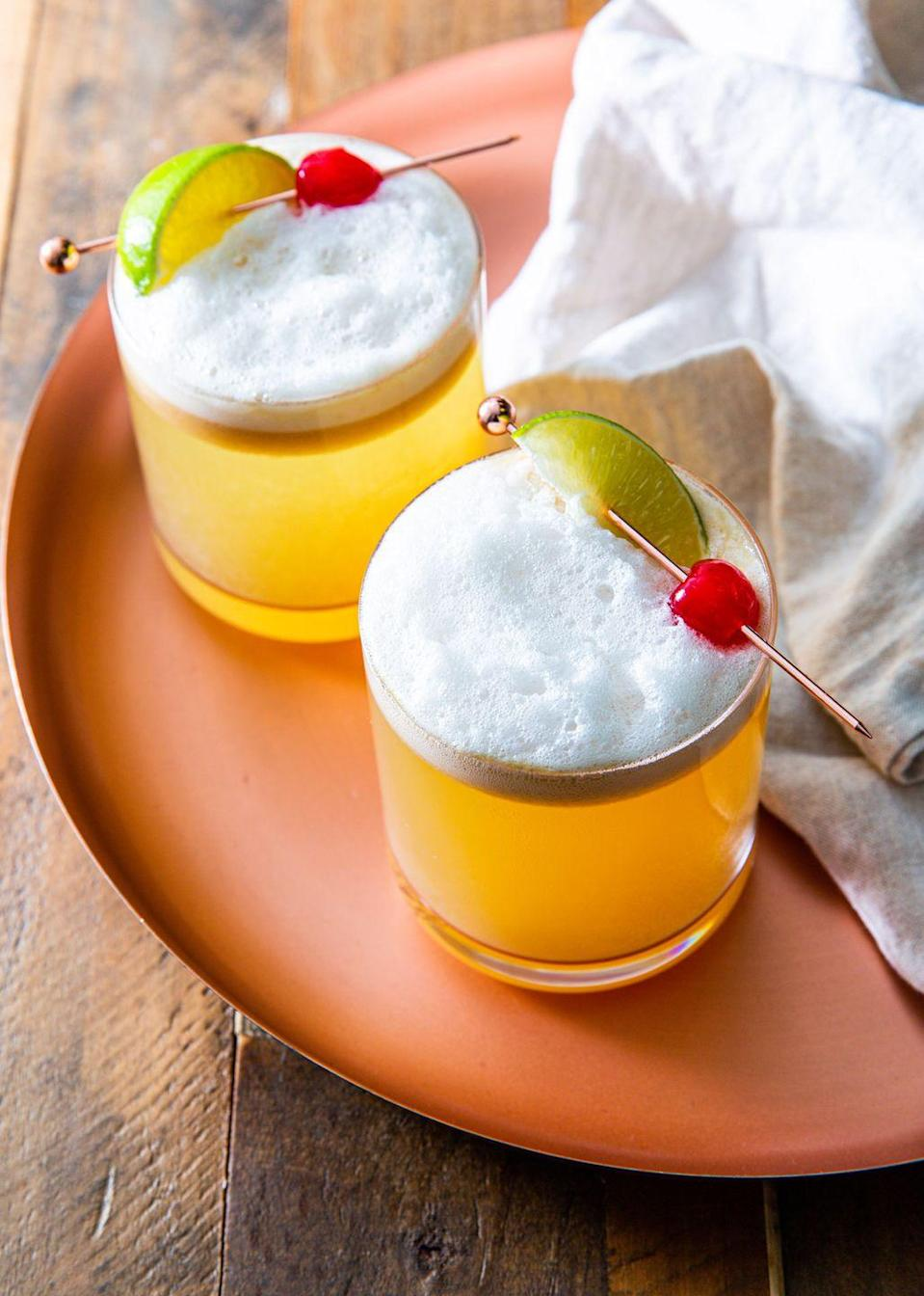 """<p>Ginger adds a spicy kick to the traditional whiskey sour. <br></p><p>Get the recipe from <a href=""""https://www.delish.com/cooking/recipe-ideas/a30121624/ginger-lime-whiskey-sour-recipe/"""" rel=""""nofollow noopener"""" target=""""_blank"""" data-ylk=""""slk:Delish"""" class=""""link rapid-noclick-resp"""">Delish</a>.</p>"""