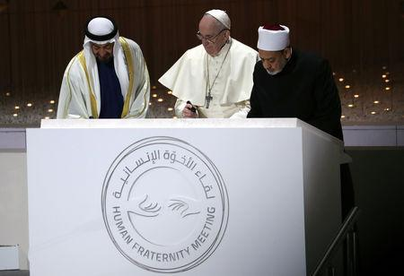 Pope Francis, Abu Dhabi's Crown Prince Mohammed bin Zayed Al-Nahyan and Grand Imam of al-Azhar Sheikh Ahmed al-Tayeb sign a document during an inter-religious meeting at the Founder's Memorial in Abu Dhabi