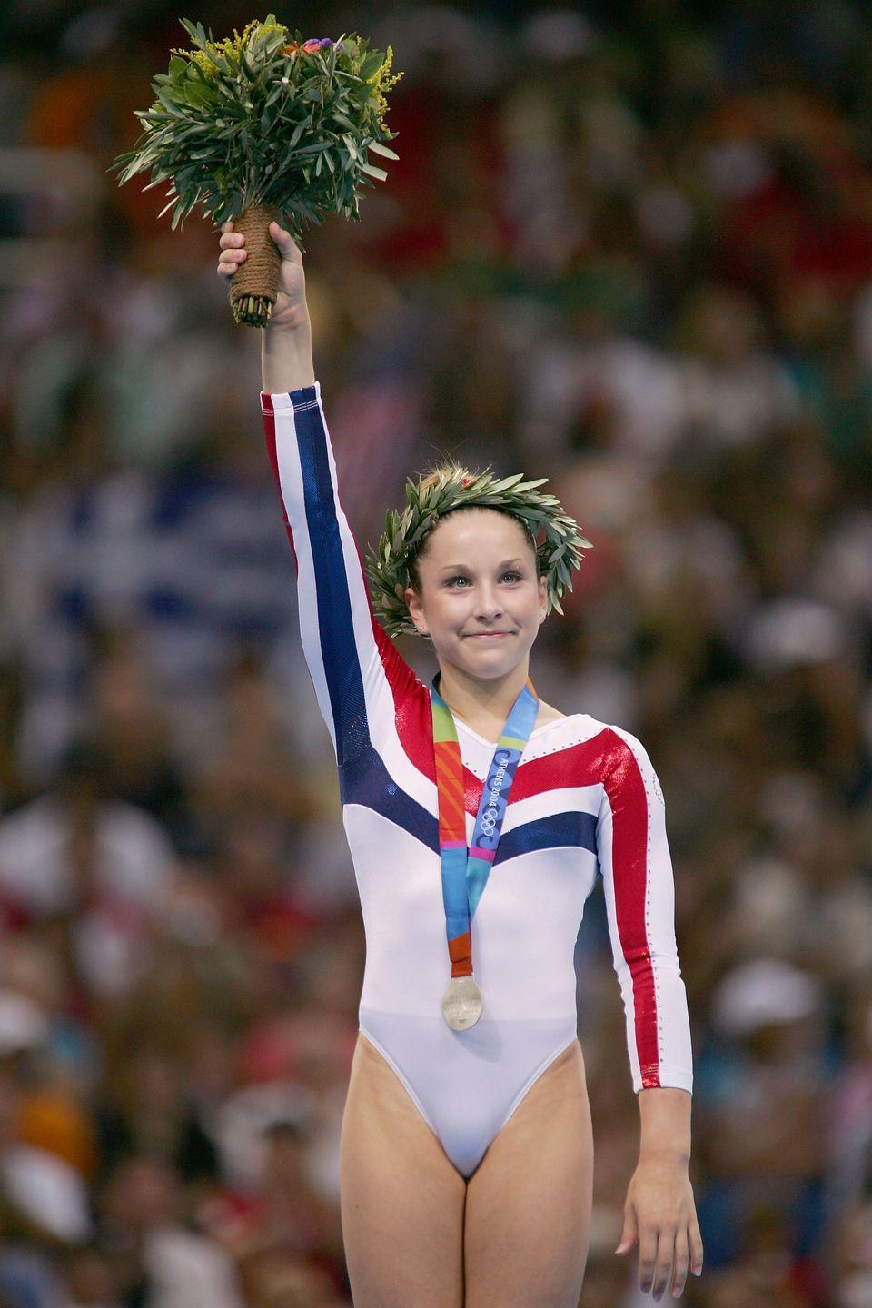"""<p>Carly Patterson competed in only one Olympics, however she made history in Athens in 2004. Patterson became the first American gymnast to <a href=""""https://olympics.com/en/athletes/carly-patterson"""" rel=""""nofollow noopener"""" target=""""_blank"""" data-ylk=""""slk:win the all-around individual award"""" class=""""link rapid-noclick-resp"""">win the all-around individual award</a> (at a non-boycotted event) in 2004 and took home one gold medal and two silver medals. </p>"""