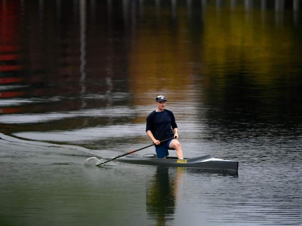 A paddler makes their way through fall colours reflected in the waters of the Rideau Canal in Ottawa, on Sunday, Oct. 10, 2021.  (Justin Tang/Canadian Press - image credit)