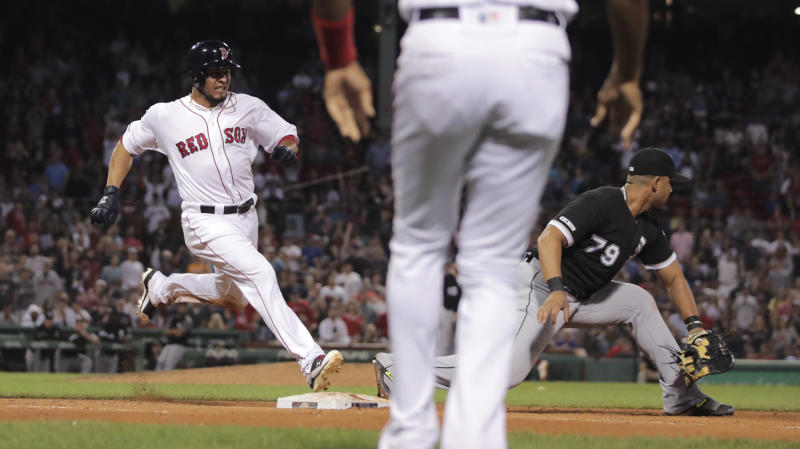 Boston Red Sox's Marco Hernandez, left, legs out his baseball game-winning bases-loaded single as Chicago White Sox first baseman Jose Abreu (79) fields the throw in the bottom of the ninth inning at Fenway Park in Boston, Monday, June 24, 2019. (AP Photo/Charles Krupa)