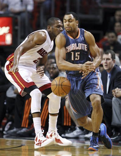 Miami Heat forward James Jones, left, strips the ball from Charlotte Bobcats guard Gerald Henderson (15) during the first half of an NBA basketball game, Friday, April 13, 2012 in Miami. (AP Photo/Wilfredo Lee)