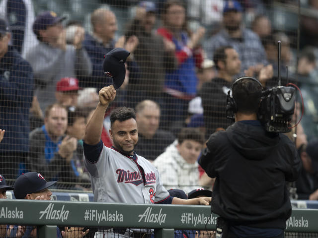 Minnesota Twins' Nelson Cruz tips his cap to fans at the end of the first inning of the team's baseball game against the Seattle Mariners, Thursday, May 16, 2019, in Seattle. Cruz played several seasons in Seattle. The Twins won 11-6. (AP Photo/Stephen Brashear)