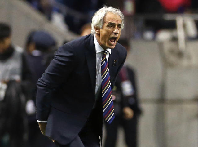 FILE - In this Nov. 15, 2016 file photo, Japan's coach Vahid Halilhodzic gives directions to his players during their 2018 World Cup Russia qualifier soccer match against Saudi Arabia, at Saitama Stadium, in Saitama, north of Tokyo. Halilhodzic is expected to be dismissed as Japan's head coach on Monday, April 9, 2018, following two disappointing international friendly matches and with the World Cup opening in just over two months. (AP Photo/Shuji Kajiyama, File)