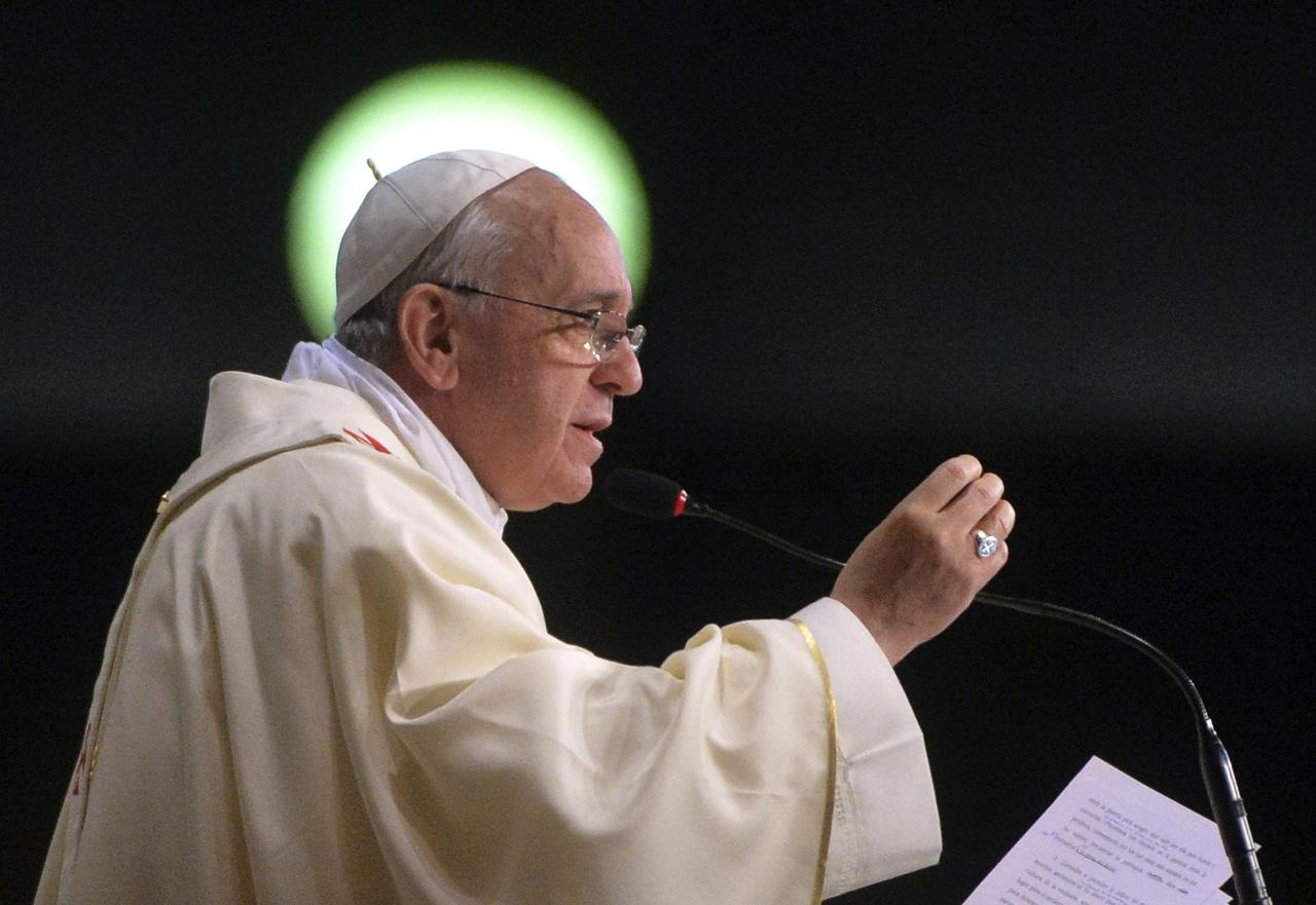 """Pope Francis celebrates mass at the Sao Sebastiao Cathedral in Rio de Janeiro, in this July 27, 2013 file photo. Pope Francis said the Catholic Church must shake off an obsession with teachings on abortion, contraception and homosexuality and become more merciful or risk the collapse of its entire moral edifice """"like a house of cards"""". REUTERS/Luca Zennaro/Pool/Files (BRAZIL - Tags: RELIGION)"""