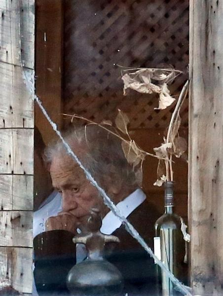 This file photo taken on September 5, 2014 shows Chilean poet Nicanor Parra inside his home in Las Cruces, some 100 km west of Santiago, on his 100th birthday
