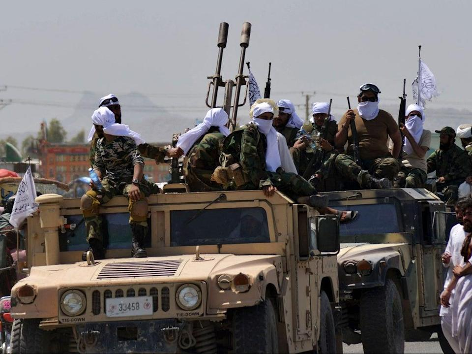 Taliban fighters atop Humvee vehicles parade along a road to celebrate after the US pulled all its troops out of Afghanistan, in Kandahar last week  (AFP via Getty Images)