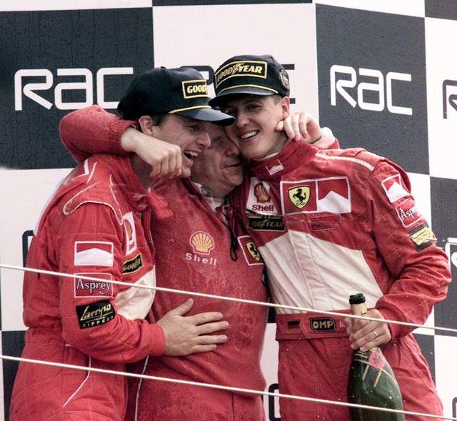 Jean Todt, centre, and Michael Schumacher, right
