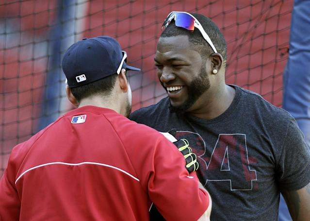 Boston Red Sox's David Ortiz, right, greets teammate Jacoby Ellsbury, left, during a baseball team workout on Tuesday, Oct. 1, 2013, at Fenway Park in Boston. The Red Sox host Game 1 of the AL divisional series on Friday, Oct. 4, against the winner of Wednesday's wild-card playoff game between the Cleveland Indians and Tampa Ray Rays. (AP Photo/Steven Senne)