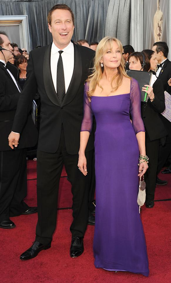 John Corbett and Bo Derek arrive at the 84th Annual Academy Awards in Hollywood, CA.