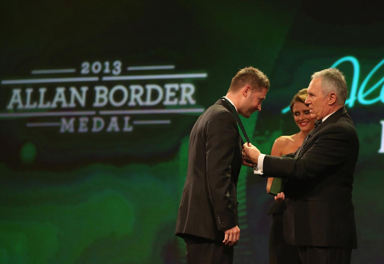 MELBOURNE, AUSTRALIA - FEBRUARY 04:  Michael Clarke (L) of Australia is presented with the the Allan Border Medal on stage by Allan Border during the 2013 Allan Border Medal awards ceremony at Crown Palladium on February 4, 2013 in Melbourne, Australia.  (Photo by Scott Barbour/Getty Images)