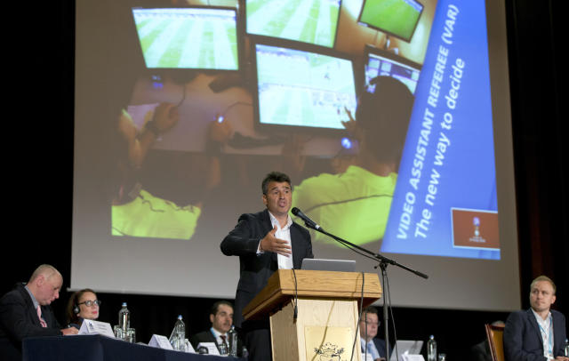 Switzerland's Massimo Busacca, FIFA-director of the Department of Refereeing Developments speaks during a media conference regarding the Video Assistant Referee (VAR) at a hotel in Brussels on Tuesday, May 8, 2018. (AP Photo/Virginia Mayo)