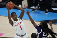 Maryland's Diamond Miller (1) passes against Northwestern's Jasmine McWilliams (23) during the second half of an NCAA college basketball semifinal game at the Big Ten Conference tournament, Friday, March 12, 2021, in Indianapolis. (AP Photo/Darron Cummings)