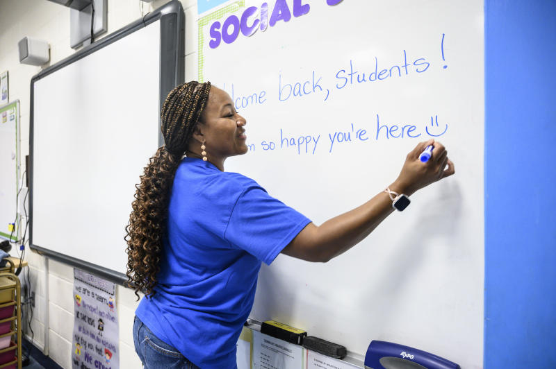 Lynbrook, N.Y.: Nyree Francis, fifth grade teacher at Davison Ave. Intermediate School in Lynbrook, New York, gets her classroom ready for the start of the new school year on August 15, 2019. (Photo by Alejandra Villa Loarca/Newsday RM via Getty Images)