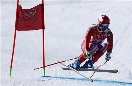 Switzerland's Didier Defago clears a gate in the first training session for the men's alpine skiing downhill event during the 2014 Sochi Winter Olympics at the Rosa Khutor Alpine Center February 6, 2014. REUTERS/Dominic Ebenbichler