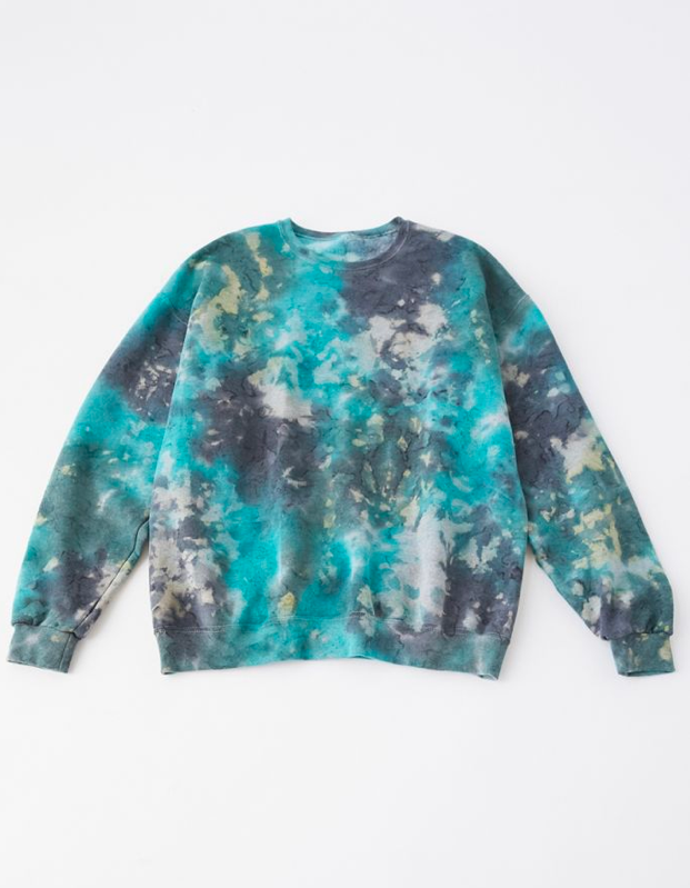 "How is she supposed to get through winter without an oversize tie-dye sweatshirt to swim in? $59, Urban Outfitters. <a href=""https://www.urbanoutfitters.com/shop/urban-renewal-recycled-lava-tie-dye-sweatshirt?color=046&type=REGULAR&size=ONE%20SIZE&quantity=1"" rel=""nofollow noopener"" target=""_blank"" data-ylk=""slk:Get it now!"" class=""link rapid-noclick-resp"">Get it now!</a>"