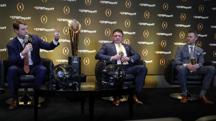 Clemson head coach Dabo Swinney, left, speaks as LSU head coach Ed Orgeron and Oklahoma head coach Lincoln Riley, right, look on during a news conference ahead for the College Football playoffs Thursday, Dec. 12, 2019, in Atlanta. Ryan Day of Ohio State was unable to attend. (AP Photo/John Bazemore)