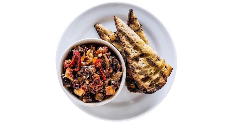 "This caponata uses a technique called a ""cold fry."" Instead of frying the vegetables in preheated, hot oil, you combine the vegetables and room temperature oil in a pot and heat them up together. <a href=""https://www.bonappetit.com/recipe/caponata-with-pine-nuts?mbid=synd_yahoo_rss"" rel=""nofollow noopener"" target=""_blank"" data-ylk=""slk:See recipe."" class=""link rapid-noclick-resp"">See recipe.</a>"