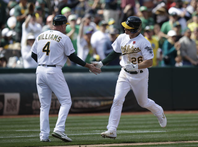 Oakland Athletics' Matt Chapman, right, is congratulated by third base coach Matt Williams (4) after hitting a home run against the Los Angeles Angels in the seventh inning of a baseball game Monday, May 27, 2019, in Oakland, Calif. (AP Photo/Ben Margot)