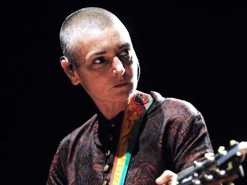 <p>Sinead O'Connor performing in 2013</p> (AFP via Getty Images)
