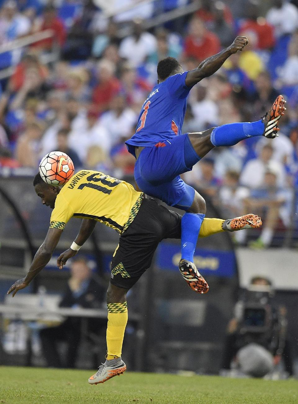 Jamaica midfielder Simon Dawkins (18) battles for the ball against Haiti defender Mechack Jerome, right, during the first half of a CONCACAF Gold Cup soccer quarterfinal, Saturday, July 18, 2015, in Baltimore. (AP Photo/Nick Wass)