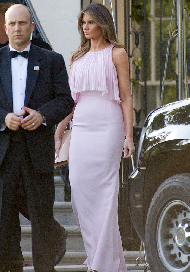Melania wore an off-white J. Mendel gown to the wedding. Photo: Getty