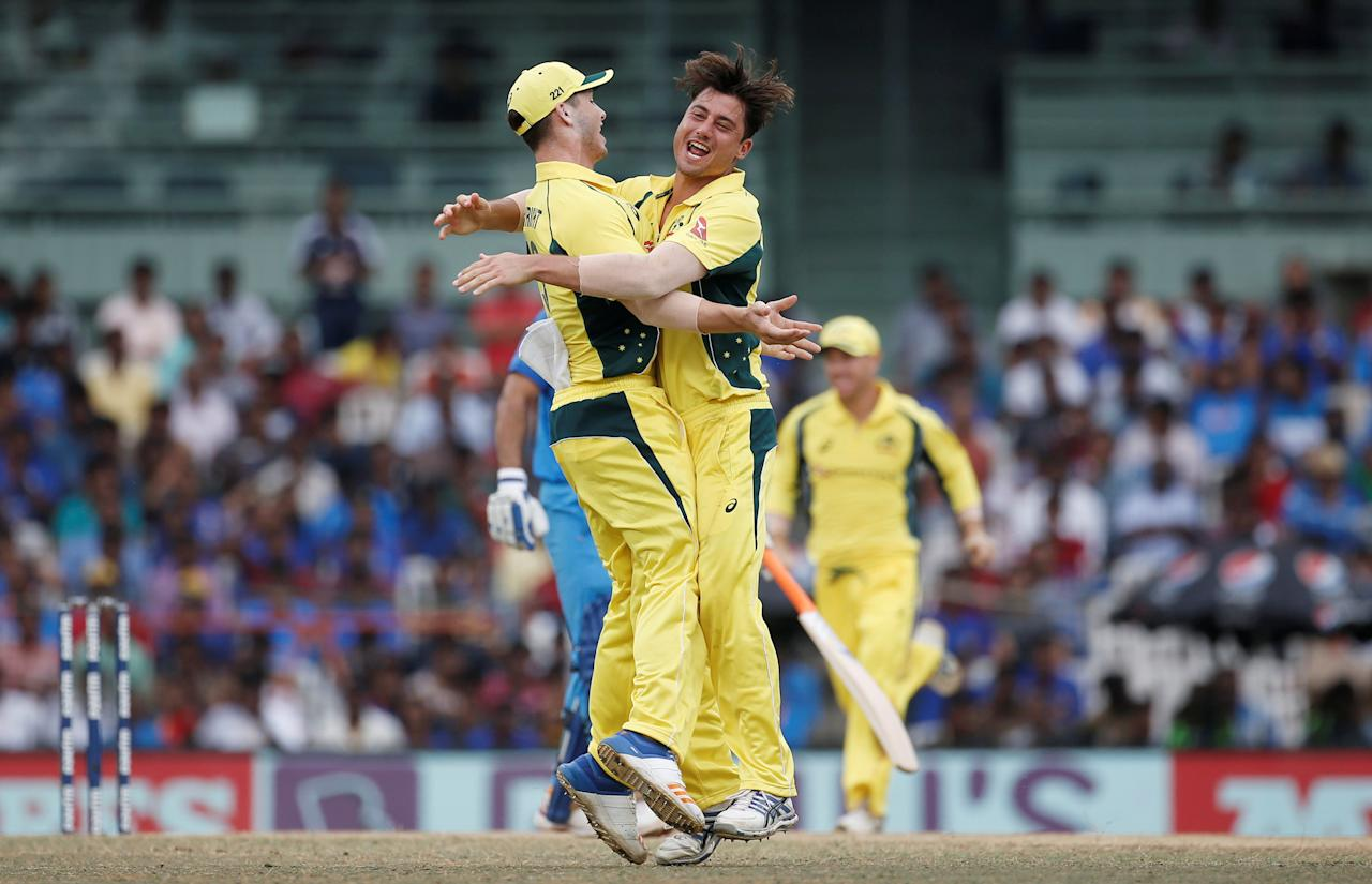 Cricket - India v Australia - First One Day International Match - Chennai, India – September 17, 2017 – Australia's Marcus Stoinis and Hilton Cartwright celebrate the dismissal of India's Kedar Jadhav. REUTERS/Adnan Abidi     TPX IMAGES OF THE DAY