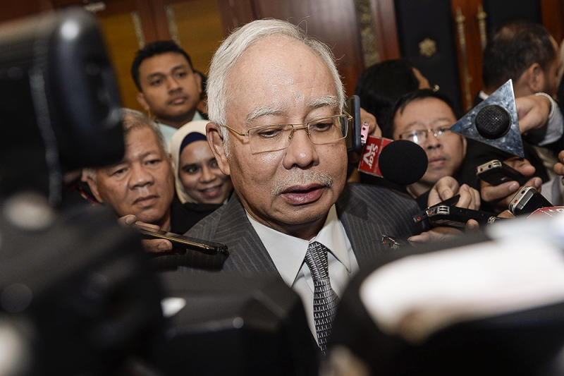 Datuk Seri Najib Razak posted documents in Facebook to prove that he had received funds donated by a member of Saudi Arabian royalty. — Picture by Miera Zulyana