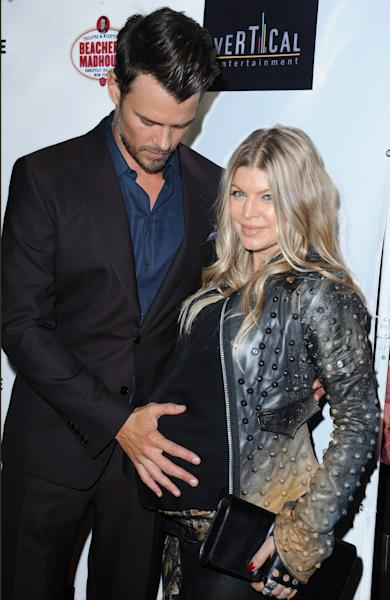 "Josh Duhamel, and his wife, Fergie, arrive on the red carpet for the premiere of ""Scenic Route"" at the Chinese 6 Theater on Tuesday, Aug. 20, 2013 in Los Angeles. (Photo by Katy Winn/Invision/AP)"