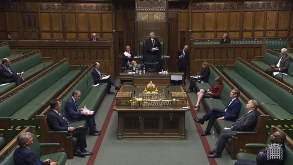 In this grab taken from video, Speaker of the House, Lindsay Hoyle presides over proceedings during Prime Minister's Questions in the House of Commons, London, Wednesday April 29, 2020. Members of Parliament observed social distancing, in an attempt to curb the spread of coronavirus. (House of Commons/PA via AP)