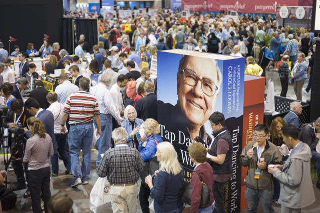 A image of Warren Buffett towers over Berkshire Hathaway shareholders as they visit and shop at company subsidiaries in Omaha, Neb., Friday, May 5, 2017, at the Berkshire Hathaway shareholders meeting. (AP Photo/Nati Harnik)