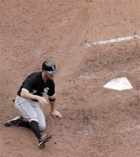 Chicago White Sox's Jeff Keppinger slides home to score on a double by Gordon Beckham during the seventh inning of a baseball game against the Kansas City Royals, Sunday, June 23, 2013, in Kansas City, Mo. (AP Photo/Charlie Riedel)