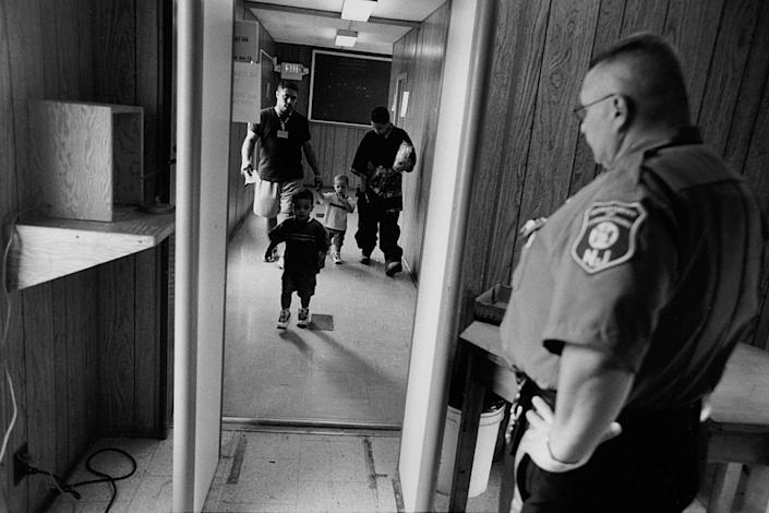 "<span class=""caption"">A family enters a women's prison in New Jersey to visit their mother.</span> <span class=""attribution""><a class=""link rapid-noclick-resp"" href=""https://www.gettyimages.com/detail/news-photo/family-enters-a-womens-prison-in-new-jersey-to-visit-their-news-photo/539606566?adppopup=true"" rel=""nofollow noopener"" target=""_blank"" data-ylk=""slk:Andrew Lichtenstein/Corbis via Getty Images"">Andrew Lichtenstein/Corbis via Getty Images</a></span>"